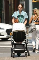 Gigi Hadid Walks to breakfast with her daughter Khai and a male friend in New York