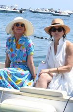 Gina Gershon & Trudie Styler Leave hotel Miramare after a conference on women and reach sting by boat in Ischia