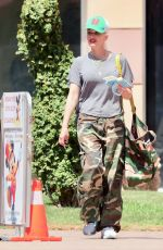 Gwen Stefani Was all smiles yet kept her distance as she flaunted her new wedding ring