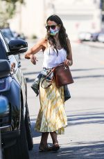 Jordana Brewster Dons a white tank top and yellow maxi skirt while out in the 90210 this morning in Beverly Hills