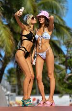 Joy Corrigan Hold hands with sister Gina during a photo shoot in Miami Beach