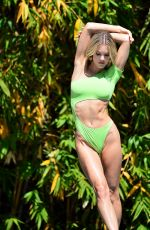 Joy Corrigan In a green swimsuit while shooting a jungle and yoga themed photo session at the Alo house in Los Angeles