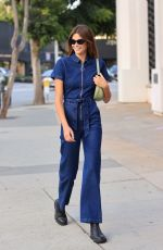 Kaia Gerber Looks every inch the model in a denim jumpsuit heading to dinner with friends in West Hollywood