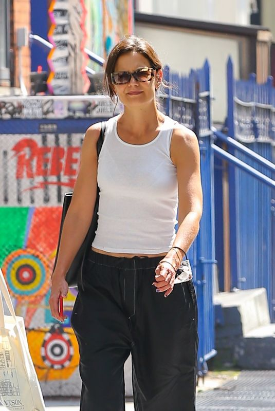 Katie Holmes Looks stunning in a casual black and white outfit while tackling a few errands around town in New York