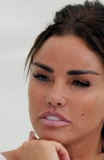 Katie Price Shows off the results of her recent surgery as she takes a trip to a local wedding fair in Essex