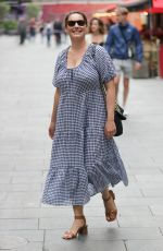 Kelly Brook Makes a busty exit from Heart radio in a gingham cotton dress in London