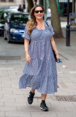 Kelly Brook Pictured arriving in a Gingham dress at the Global Radio Studios for her Heart Radio Show in London
