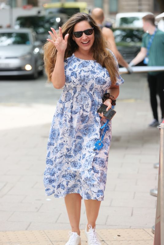 Kelly Brook Wears a floral dress at Heart Radio in London