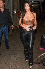 Kim Kardashian Puts on an eye popping display in a strapless top and leather pants while out to dinner in New York
