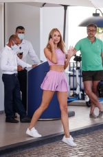 Kimberley Garner Looks cute as she is spotted in a pink mini skirt and pink crop top at the Martinez Hotel during the 74th Cannes Film Festival