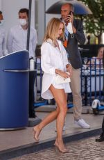Kimberley Garner Looks stunning in white T-Shirt dress and Channel bag outside the Martinez Hotel during the 74th Cannes Film Festival