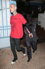 Kourtney Kardashian Gets camera shy as she hides behind her beau Travis Barker while leaving a dinner date in Los Angeles