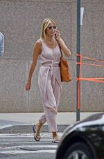 Kristen Taekman Wears a pink outfit while talking on her cellphone in the West Village in New York