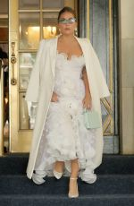Lady Gaga In a white lace and ruffle dress with a mint purse in New York City