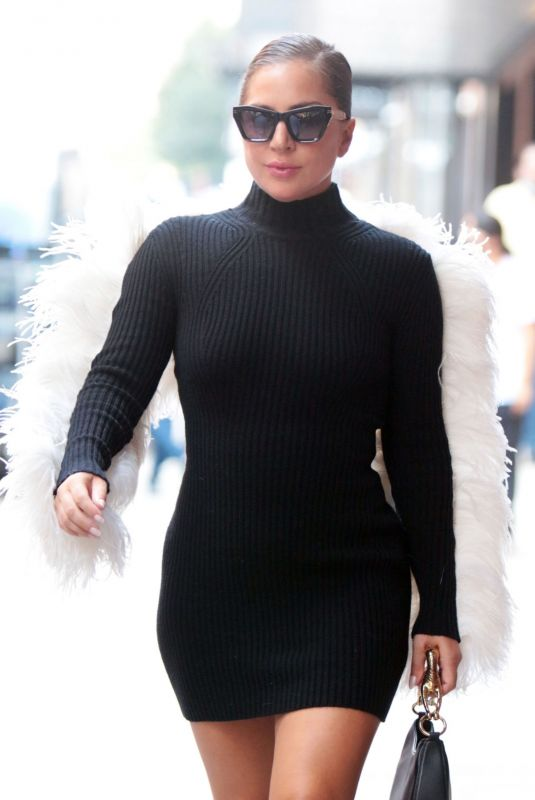 Lady Gaga Stuns in black dress with white feather fringe and signature black platform heels leaving milk studios in New York