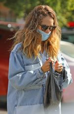 Lily James Visits a smoke shop with a friend in Los Angeles