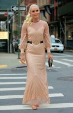 Lindsey Vonn Stuns in a Gucci dress with gold high heels in New York