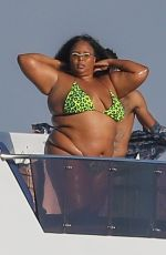 Lizzo Poses for pictures in a green bikini on a mega yacht in Marina del Rey