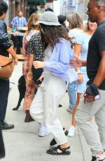 Lorde Poses with a fan as she arrives for the taping of The Late Show With Stephen Colbert in New York City