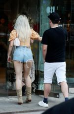 Lottie Moss Gets cheeky as se rocks denim short shorts while arriving at 180 Strand in London
