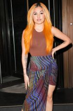 Mabel Turns heads with bright orange hair heads to Mayfair eatery in Lndon