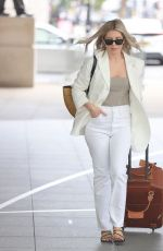 Mollie King Looks chic in a cream blazer and white denim at BBC Radio 1 in London