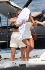 Molly-Mae Hague Pictured wearing a white dress with a brown YSL Handbag as she