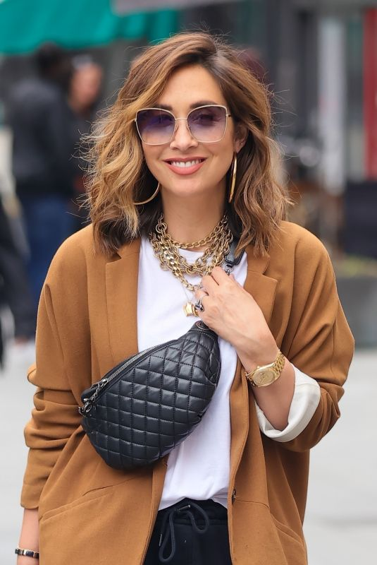 Myleene Klass Looks chic in a Suede Jacket and loose trousers at Smooth radio in London