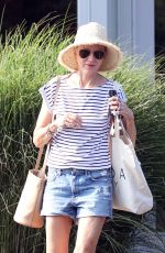 Naomi Watts All smiles while going on a shopping spree in The Hamptons, New York