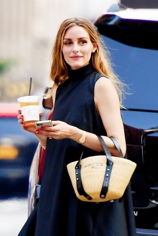 Olivia Palermo Steps out in a black maxi dress with a Giambattista Valli logo top-handle straw tote in New York