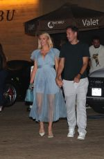 Paris Hilton Resembles a Disney princess donning a baby blue dress as she steps out for dinner with her fiance Carter Milliken Reum at Nobu in Malibu