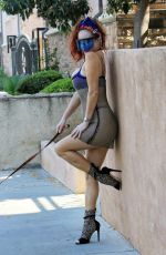 Phoebe Price Posing with her dog wearing a sliver see-through dress on Tuesday in Los Angeles