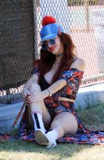 Phoebe Price Seen in a flower print dress and posing around the park on Monday in Los Angeles