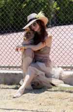 Phoebe Price Seen posing barefooted with her dog at the park