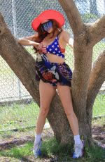 Phoebe Price Shows off her patriotic colors as she heads to the park and picks up a party pizza as a prop in Los Angeles