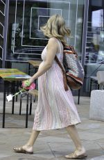 Rachel Riley Flashes baby bump while leaving Countdown in Manchester