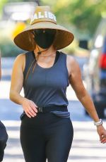 Reese Witherspoon Wears her Malibu straw hat while out for a walk with a friend and a personal trainer