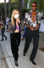 Rita Ora Wears a plunging purple top to dinner with a friend in Los Angeles