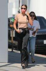 Sofia Richie Goes shopping with a friend and her dog at Saint Laurent on Rodeo Drive in Beverly Hills