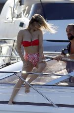 Sophie Hermann In a red and cherry bikini in aboard a yacht as she enjoys a sunny afternoon in Ibiza