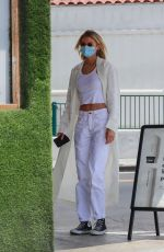 Stella Maxwell Goes out for coffee and stops by a cannabis store with a friend in Los Angeles