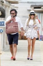 Sylvie Meis and husband Niclas Castello enjoy the beach at Club 55 during holidays in St-Tropez