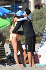 Alessandra Ambrosio In a green bikini as she enjoys a beach day with her boyfriend and her friends in Los Angeles