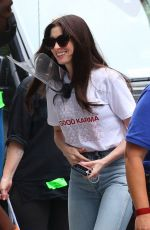 Anne Hathaway Shows off her pearly whites on the set of