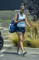 April Love Geary Wraps up a tennis match in Malibu