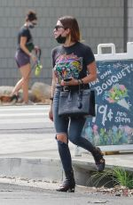 Ashley Benson Rocks a Foghat vintage tee with ripped jeans and Gucci boots while out in Los Feliz