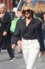 Ashley Roberts Looks chic in white denim jeans and black top outside the Heart Radio Studios in London