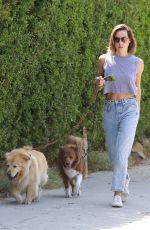 Aubrey Plaza Cuts a casual figure in jeans and a grey crop top as she takes her dogs for a walk in Los Feliz