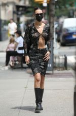 Bella Hadid Wears a sheer embroidered top with no bra and matching skirt with knee-length boots in New York