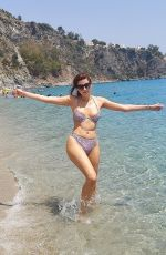 Blanca Blanco Shows off her curves as she enjoys a beach day while vacationing in Cantazaro, Italy